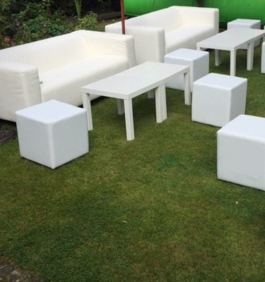 White sofas white cubes white coffee tables for events copy