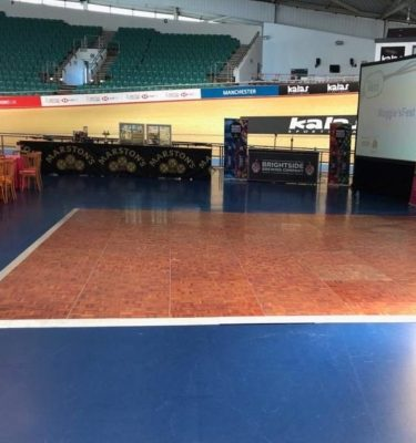 Wooden-Parquet-Dance-Floor-Hire-manchester-Velodrome-Cheltenham-Spindleback-natural-Bentwood-Chair-Hire-1024x768 (1)