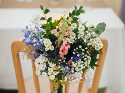 Cheltenham natural wood wedding chair with chair flowers