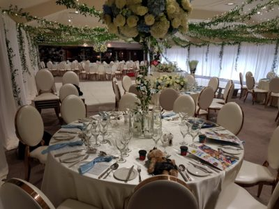 Gold Louis Dior chairs with faux ivory leather seat pads and wonderful blue and ivory wedding flowers