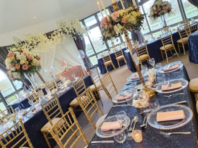 Gold chivari chairs with gold and blue wedding theme large gold candelabra