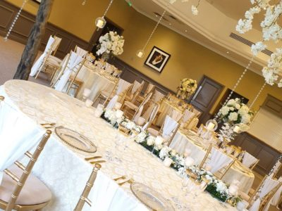 Gold chivari chairs with ivory draylon seat pad and chair drape