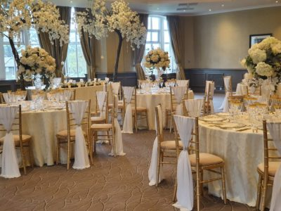 Gold chivari chairs with ivory draylon seat pads & ivory chair drapes