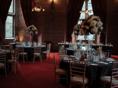 Gold chivari wedding chairs and ivory seat pads at Peckforton Castle