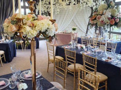 Gold chivari wedding chairs with ivory draylon seat pads gold and blue theme