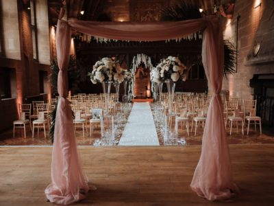 Gold chivari wedding chairs with ivory seat pads at Peckforton Castle