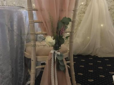 Limewash chivari chair with chair wedding flowers