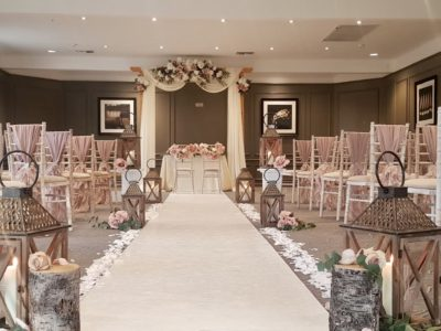 Limewash chivari chair with ivory draylon seat pads and pink chair drapes lanterns along wedding aisle pink wedding theme