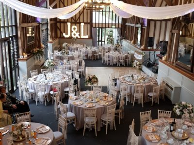 Limewash chivari chairs in rustic wedding venue