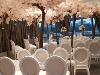 Louis Dior white chairs with stunning floral trees