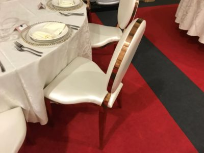 Rose Gold Louis Dior chairs with satin table cloths wedding and event chairs