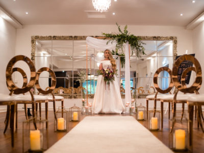 Rose Gold halo wedding chair with gold lanterns along aisle @ Sparth House
