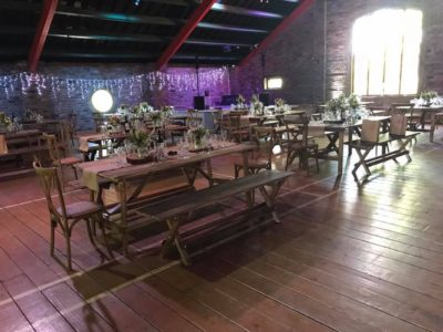 Rustic benches and vintage shappy chic tables with hessian runners