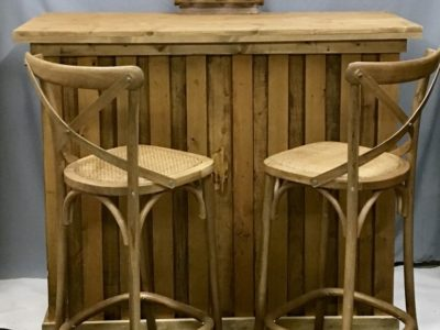 Vintage rustic wooden bar and cross back oak bar stools