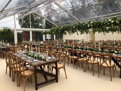 Weathered Oak Cross back wedding chairs and vintage trestle tables