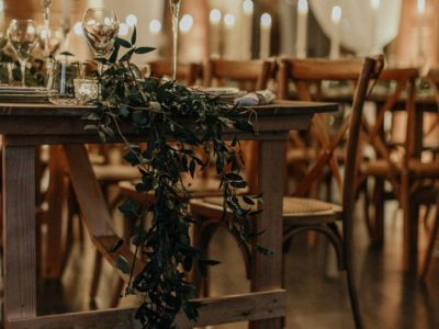 Weathered oak rustic chairs & vintage trestle tables with foliage garlands natural wedding theme