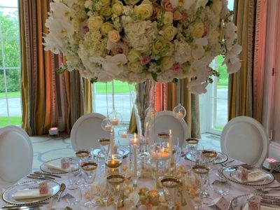 White Louis Dior chairs with elegant ivory pink and gold wedding theme at Rudding Park