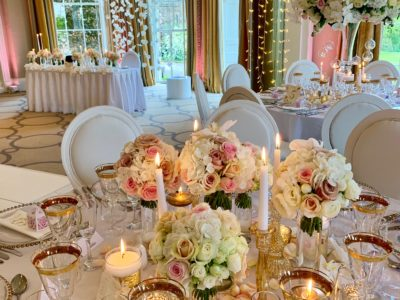 White Louis Dior chairs with elegant wedding flowers ivory and pink Rudding Park