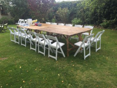 White folding ceremony chairs for outside event