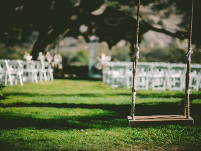 White folding wedding ceremony chairs