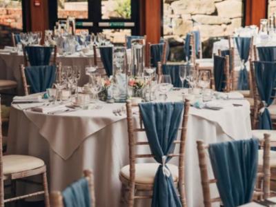 Limewash chivari chairs with grey blue chair drapes
