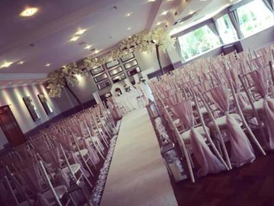 Limweash chivari chairs with bluch drapes wedding ceremony