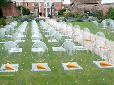 Victoria Ghost chairs in garden wedding ceremony