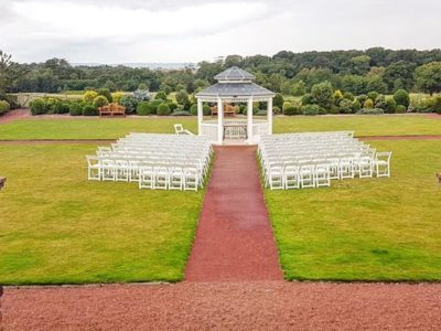 White ceremon chairs with gazebo outdoor weddig ceremony