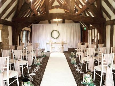 White chivari chairs in rustic barn setting